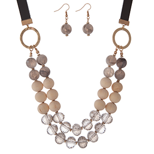 "Gold tone necklace set with gray natural stone, tan wooden, and gray faceted beads and matching fishhook earrings. Approximately 16"" in length."