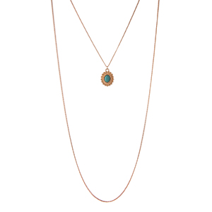 "Dainty, gold tone, double layer necklace set with a turquoise stone pendant and six pairs of matching stud earrings. Approximately 18"" in length."