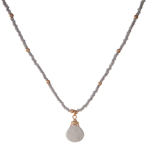 """Dainty, gray, beaded necklace with a howlite stone pendant and gold tone accents. Approximately 14"""" in length."""