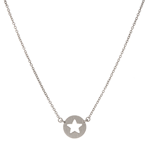"Dainty silver tone necklace with a circle pendant displaying the cutout of a star. Approximately 16"" in length."
