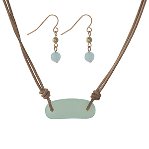 "Brown cord necklace set with a mint green sea glass stone and matching fishhook earrings. Approximately 16"" in length."