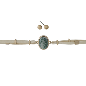 """Tan faux suede wrap necklace with a green stone focal and gold tone accents. Can also be worn as a bracelet. Approximately 40"""" in length."""
