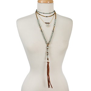 "Bronze, blue, and mint beaded layered necklace with natural stones and a tassel pendant. Approximately 12"" in length."