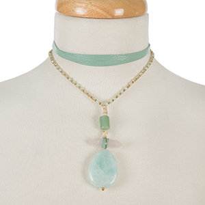 """Gold tone and mint green leather wrap choker necklace with a three stone mint pendant. Approximately 66"""" in length."""