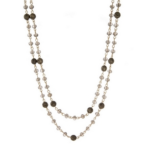 "Gold tone wrap necklace with gray and pyrite beads. Approximately 60"" in length."