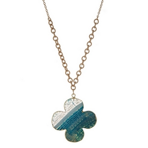 """Gold tone necklace with a blue natural stone, flower shaped pendant. Approximately 32"""" in length."""