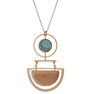 """Burnished gold tone necklace with a geometric wooden and turquoise stone pendant. Approximately 32"""" in length."""