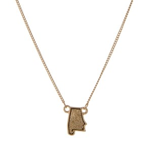 "Gold tone necklace with a faux druzy stone in the shape of Alabama. Approximately 15"" in length."