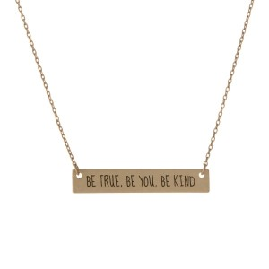 "Matte gold tone bar necklace stamped with ""Be True, Be You, Be Kind."" Approximately 14"" in length."