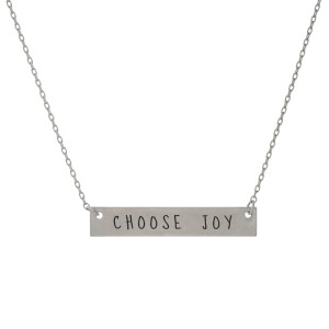"""Matte silver tone bar necklace stamped with """"Choose Joy."""" Approximately 14"""" in length."""