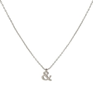 "Dainty silver tone necklace with an ampersand pendant. Approximately 14"" in length."