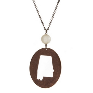 "Burnished copper tone necklace with a Alabama cutout pendant accented by a pearl bead. Approximately 30"" in length."