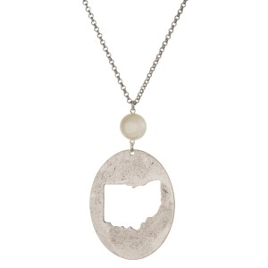 "Burnished silver tone necklace with an Ohio cutout pendant accented by a pearl bead. Approximately 30"" in length. Oval pendant is approximately 2.5"" tall."