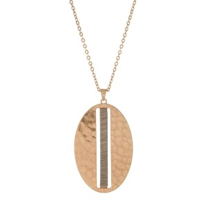 "Gold tone necklace with a hammered gold tone pendant, accented with silver tone wire. Approximately 32"" in length."