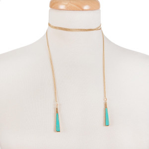 "Gold tone open wrap necklace with turquoise natural stones on the ends. Approximately 60"" in length."