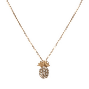 "Dainty gold tone necklace featuring a pineapple pendant with rhinestones. Length adjusts from 16""-18""."