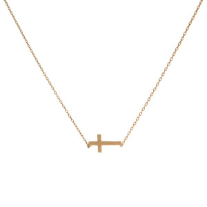 "Dainty gold tone necklace with an 8mm cross pendant. Length adjusts from 16""-18""."