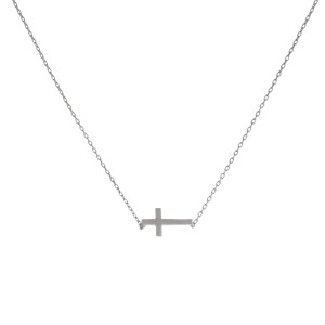 "Dainty silver tone necklace with an 8mm cross pendant. Length adjusts from 16""-18""."
