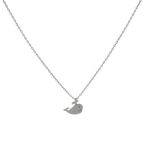 """Dainty silver tone necklace with a small whale pendant. Pendant approximately 7mm. Length adjusts from 16""""-18""""."""