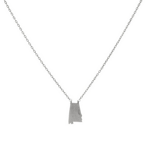"Dainty silver tone necklace featuring a brushed Alabama shaped pendant. Pendant approximately 7mm in length. Length adjusts from 16""-18""."