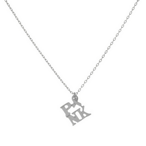 """Dainty silver tone necklace featuring a small pendant that reads """"PINK"""" with a breast cancer awareness symbol. Pendant is approximately 7mm. Length adjusts from 16""""-18""""."""