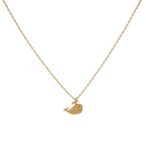 "Dainty gold tone necklace with a small whale pendant. Pendant is approximately 7mm. Length adjusts from 16""-18""."