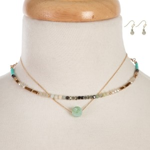 "Two layer choker featuring a mint green and ivory beaded memory wire choker and a dainty gold tone layer with a jade natural stone bead. Approximately 12"" and 13"" in length."