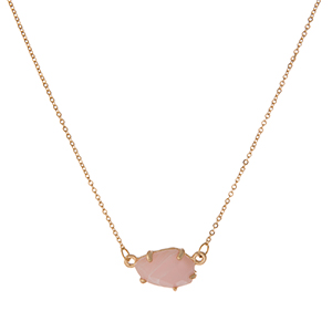 "Dainty gold tone necklace with a pale pink stone pendant. Approximately 16"" in length."