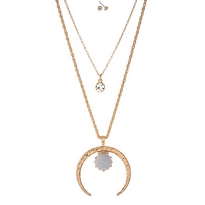 "Gold tone, two layer necklace set displaying a crescent pendant accented by a light blue stone and matching stud earrings. Approximately 30"" and 32"" in length."