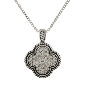 "Silver tone necklace featuring a clover double-sided pendant, accented with clear pave rhinestones. Approximately 36"" in length."
