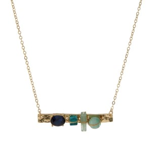 "Dainty gold tone bar necklace with mint and blue stones and rhinestones. Approximately 16"" in length."