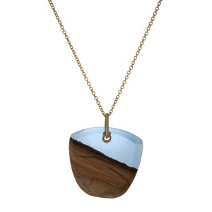 "Gold tone necklace featuring a wooden and light blue resin pendant. Approximately 32"" in length."