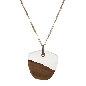 "Gold tone necklace featuring a wooden and clear resin pendant. Approximately 32"" in length."