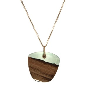 "Gold tone necklace featuring a wooden and green resin pendant. Approximately 32"" in length."