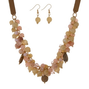 "Tan faux leather necklace set featuring tan, pale pink, and picture jasper beads and stones. Approximately 18"" in length."