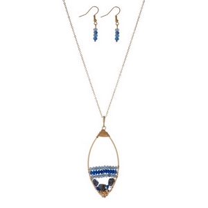 "Gold tone necklace set displaying an open teardrop shape with wire wrapped blue beads. Approximately 32"" in length."
