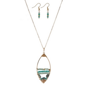 "Gold tone necklace set displaying an open teardrop shape with wire wrapped mint green beads. Approximately 32"" in length."