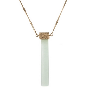 "Gold tone necklace displaying a mint green, natural stone, rectangle pendant. Approximately 32"" in length."