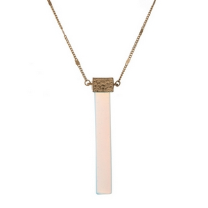 "Gold tone necklace displaying an opal, natural stone, rectangle pendant. Approximately 32"" in length."