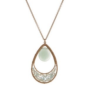 "Gold tone necklace with a mint green natural stone and beaded teardrop pendant. Approximately 32"" in length."