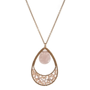 "Gold tone necklace with a pale pink natural stone and beaded teardrop pendant. Approximately 32"" in length."