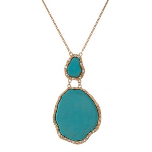 "Matte gold tone necklace displaying two turquoise natural stone pendants. Approximately 30"" in length."