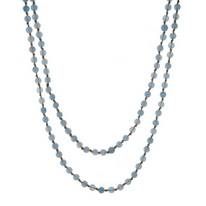 "Tan knotted cord wrap necklace displaying light blue natural stone beads. Approximately 60"" in length."
