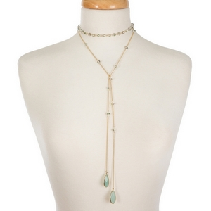 "Gold tone wrap necklace displaying iridescent beads and mint green semi-precious stones on the ends. Approximately 50"" in length."