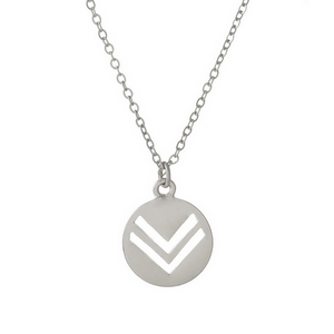 "Dainty silver tone necklace featuring a circle pendant with two triangle cutouts. Approximately 16"" in length."