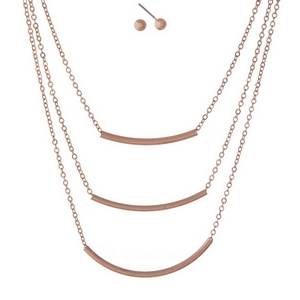 "Dainty rose gold tone, three layer necklace set featuring three curved bar pendants. Approximately 14"" to 18"" in length."