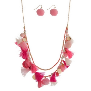 "Gold tone necklace featuring pale pink and hot pink tassels, beads and pom poms. Approximately 24"" in length."