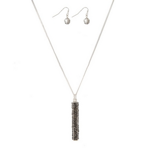 """Silver tone necklace set featuring a hematite pendant and matching fishhook earrings. Approximately 32"""" in length."""