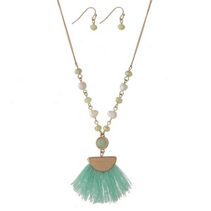 "Gold tone necklace set featuring freshwater pearl beads, a mint fabric tassel pendant and matching fishhook pendant. Approximately 22"" in length."