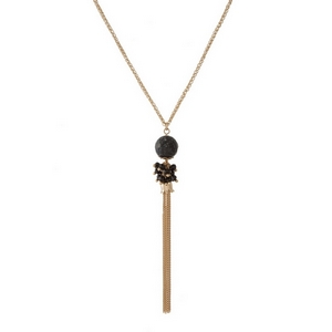 """Gold tone necklace featuring a black natural stone pendant and chain tassel. Approximately 30"""" in length."""